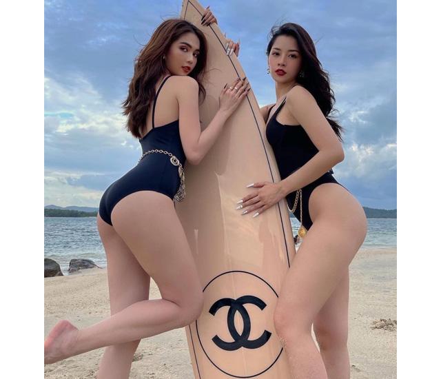 """anh chi pu bikini dep - Chi Pu pose dáng cùng """"nữ hoàng nội y"""" Ngọc Trinh bên chiếc ván 250 triệu"""